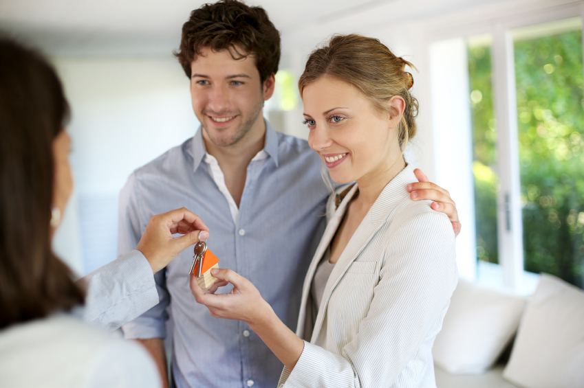 couple getting keys of their furnished apartment